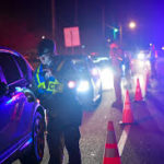 Officers check IDs at DUI Checkpoint
